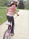 Woman riding bicycle outdoors