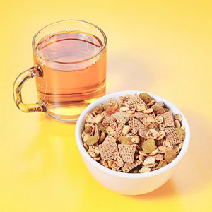 Bowl of granola and tea with honey