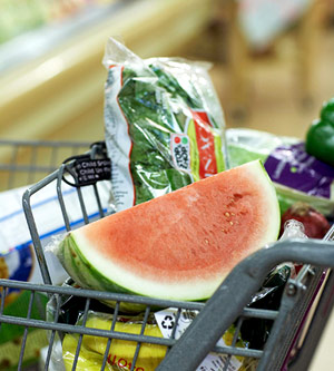 supermarket grocery cart with produce