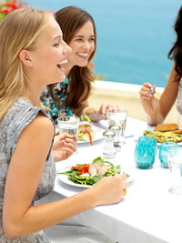 young women eating at restaurant