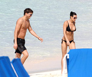 Demi Moore and Ashton Kutcher at the beach