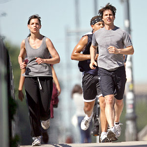 Katie Holmes and Tom Cruise running