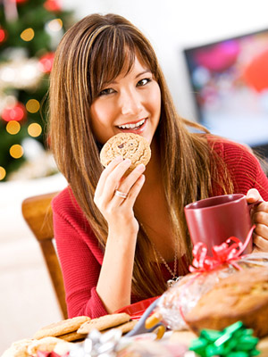 Girl eating Christmas cookie