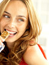 woman eating snack bar