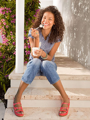 model eating yogurt