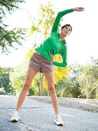female runner stretching outdoors