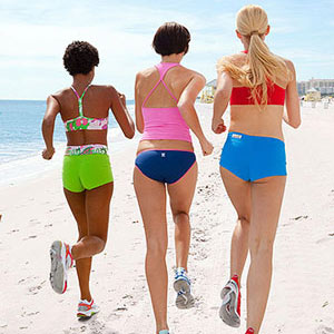 women running on the beach