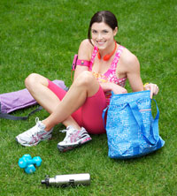 woman with workout gear on the grass