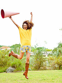 woman jumping with horn