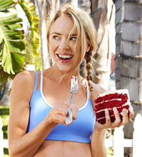 woman in workout clothes eating cake