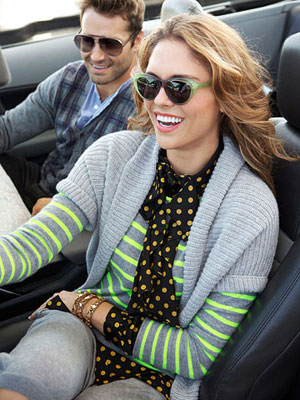 woman wearing a sweater, driving
