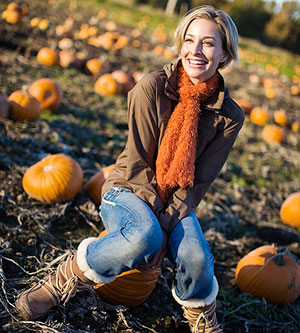 Woman in pumpkin patch