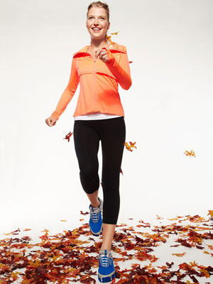 woman walking on fall leaves