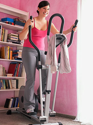 woman exercising on the elliptical trainer