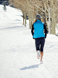 woman in blue jogging in winter