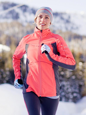 woman in bright jacket jogging in winter