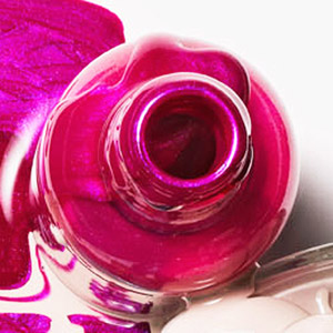Sally Hansen nail polish in Posh Plum