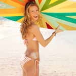 woman with a surfboard on the beach