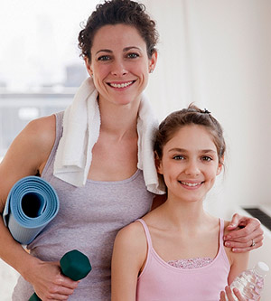 woman and daughter yoga
