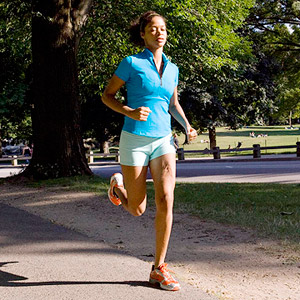 woman running through park