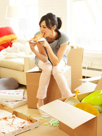 Woman eating pizza in  new apartment