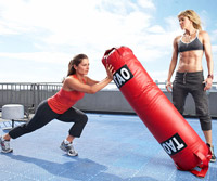 woman and trainer working out