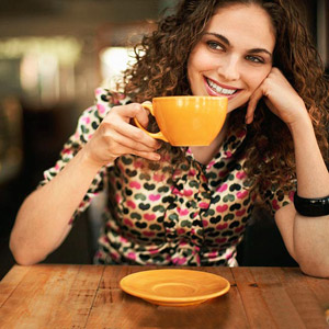 woman drinking cup of coffee