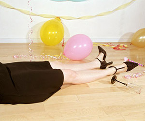 woman sleeping on the floor after a party