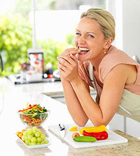Woman eating veggies