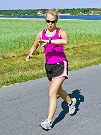 Woman running looking at watch