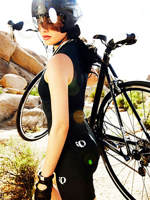 Woman with stylish workout clothes and bike