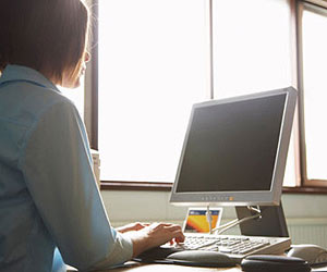 Woman sitting at computer at work