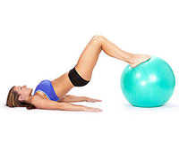 Woman doing ab exercises on a BOSU ball