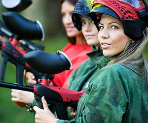 Woman paintballing