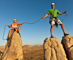 Couple rock climbing