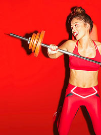 Girl with barbell and weights