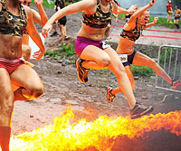 Girls jumping over fire, racing