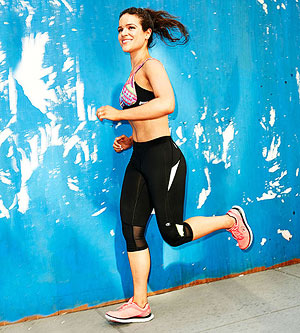 Monica Vazquez running in sports bra.