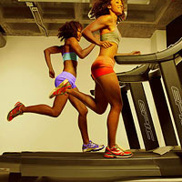 Girls running on treadmills.