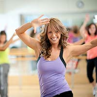 Woman dancing in Zumba class.