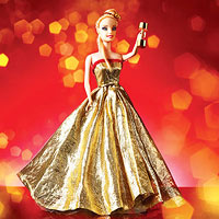 Barbie doll in evening gown, holding dumbbell