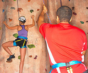 Man and woman rock climbing