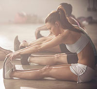 Women stretching together