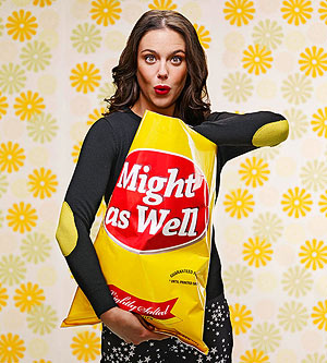 Woman digging into giant bag of chips.