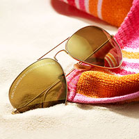 Sunglasses resting in sand
