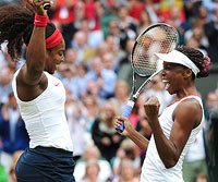 Serena and Venus Williams celebrate their 2012 doubles victory at Wimbledon.