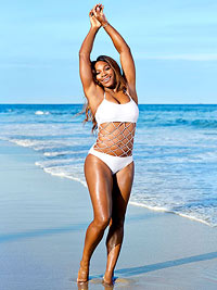 Serena Williams on beach in one-piece cutout white swimsuit