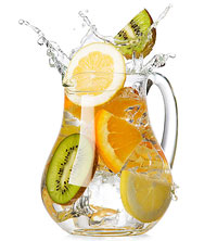 Clear water pitcher infused with fruit, lemon, lime, orange