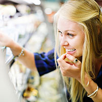 Woman browsing grocery shelves