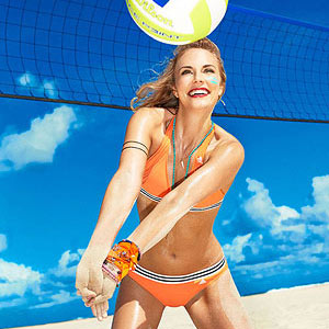 Woman playing beach volleyball in bikini